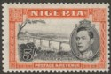 Nigeria 1938 KGVI 5sh Black and Orange perf 13x11½ Mint SG59
